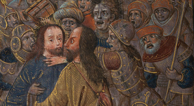 Judas identifies Jesus before a group of angry soldiers