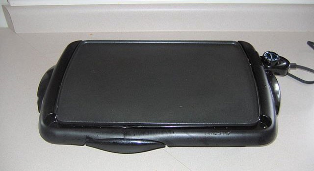 A hotplate sitting on a kitchen counter