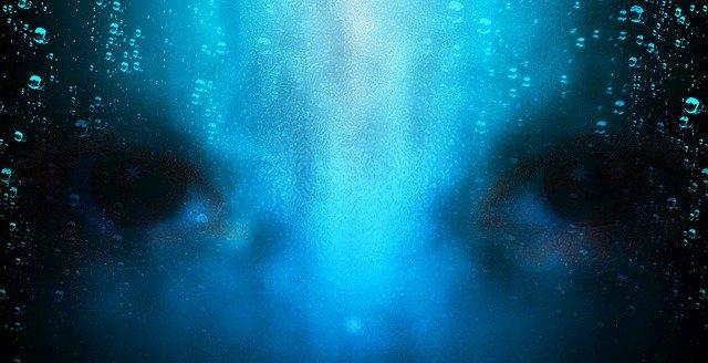 Murky closeup of a human face underwater